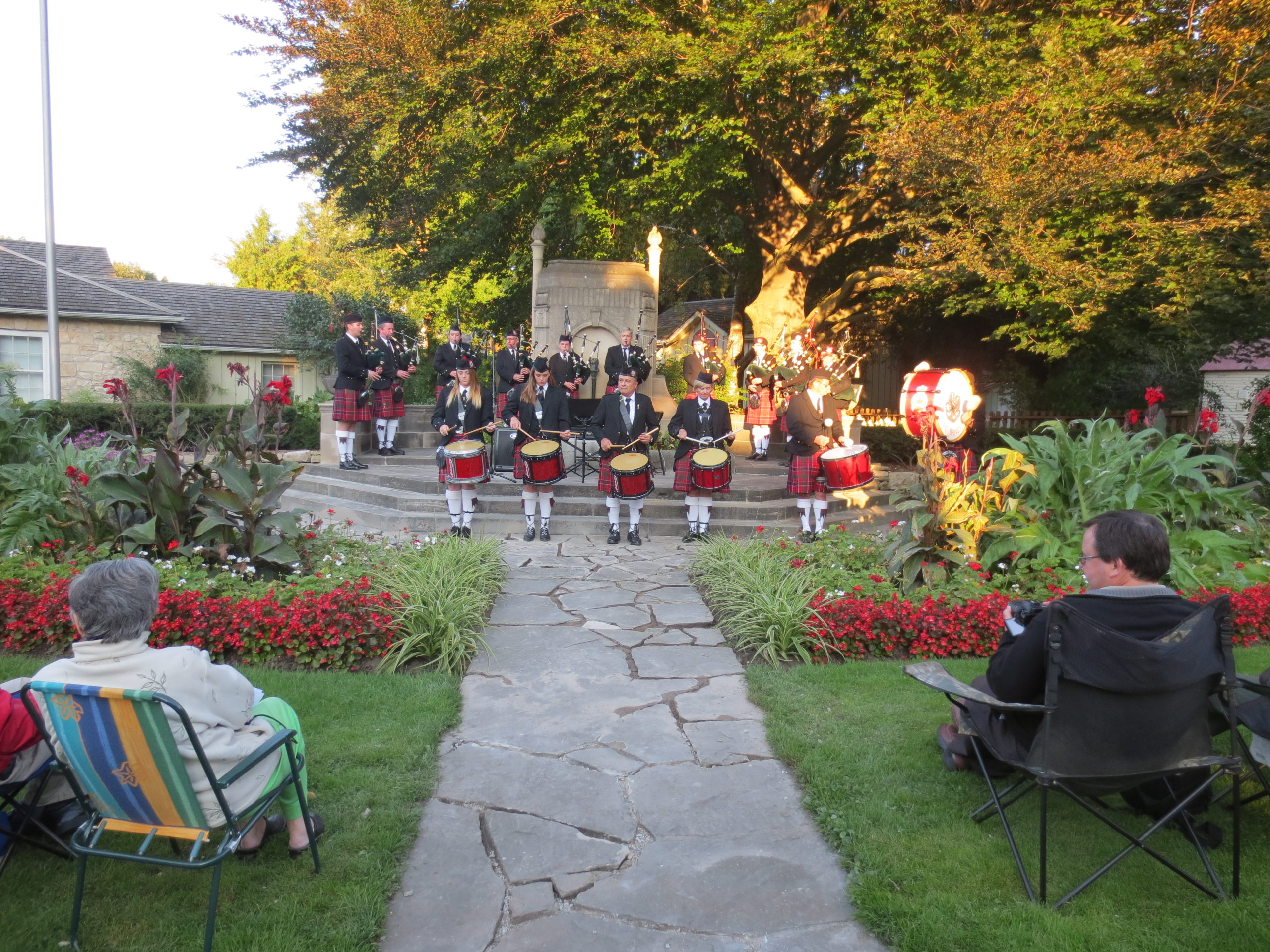 Photo of the Guelph Pipe Band performing at McCrae Memorial Gardens, 2004.