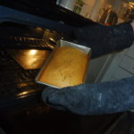 Kens Ginger Bread demonstration - taking the bread out of the oven